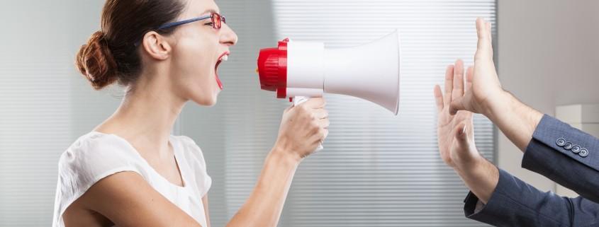Businesswoman shouting in megaphone