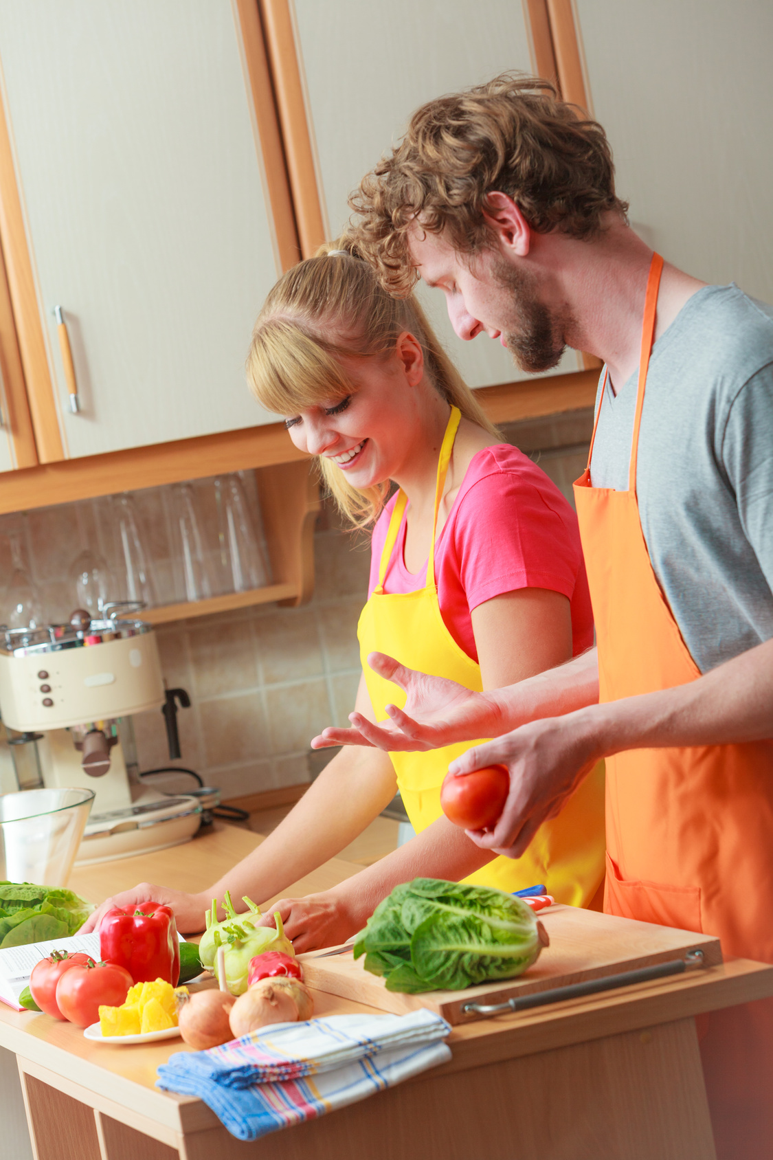 Couple preparing fresh vegetables food salad
