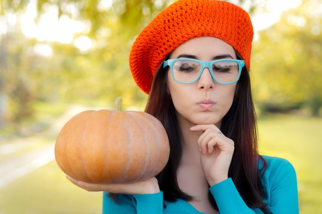 Funny Woman Wearing Glasses Holding Pumpkin