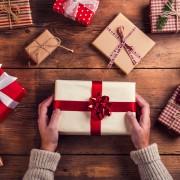 Man holding Christmas present