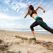 sports woman running on seaside