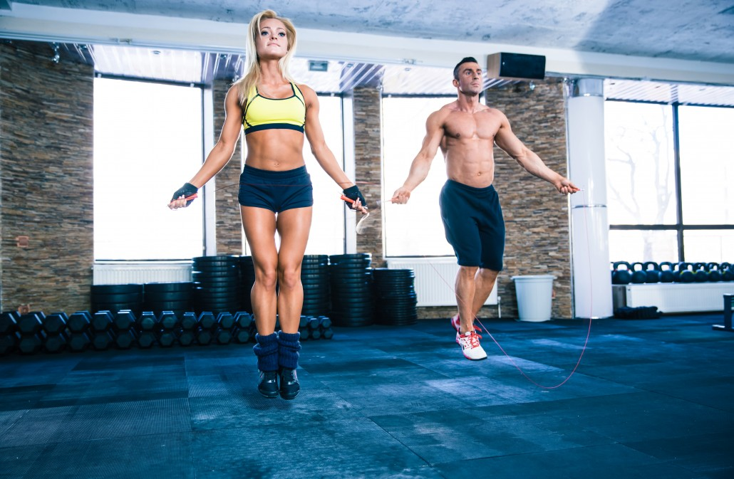 Fitness man and woman workout with jumping rope