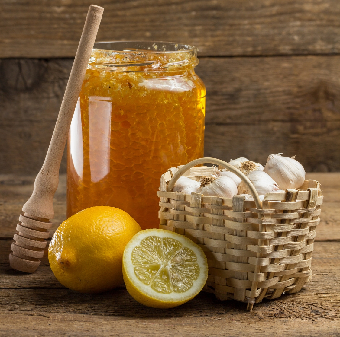 Lemon, garlic and jar of honey
