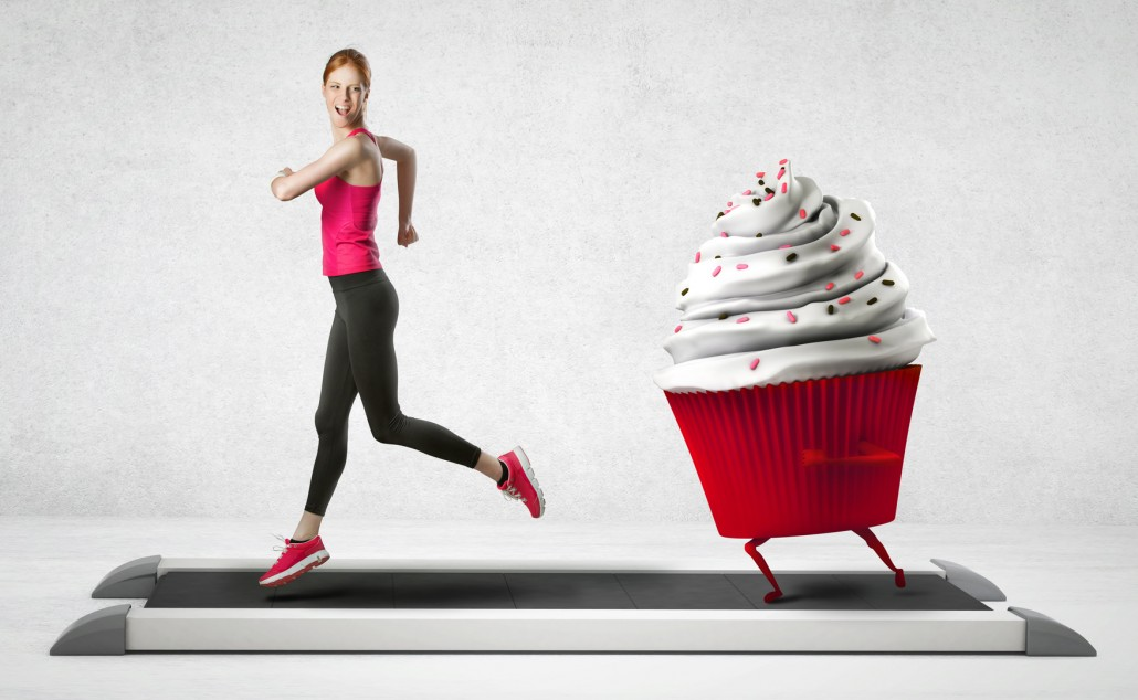 Woman running away from a cupcake