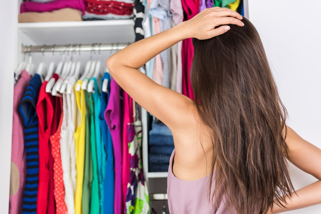 Indecision woman choosing outfit in clothes closet