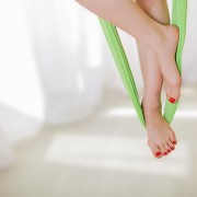 female legs with a nice manicure, gymnastic exercises