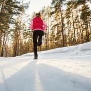 The girl running in winter Park