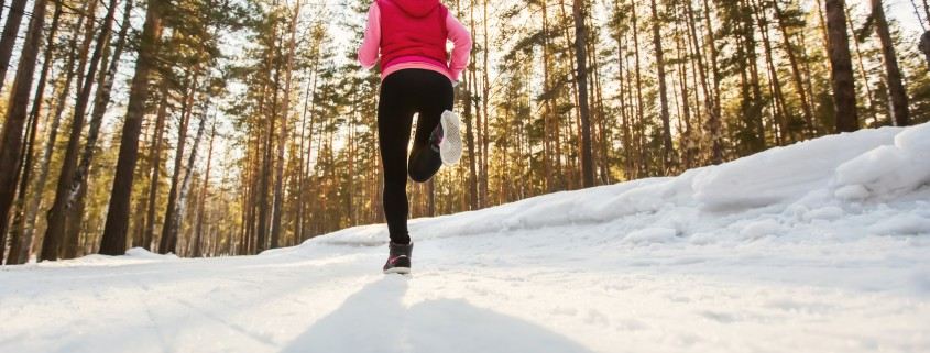 The girl running in winter Park