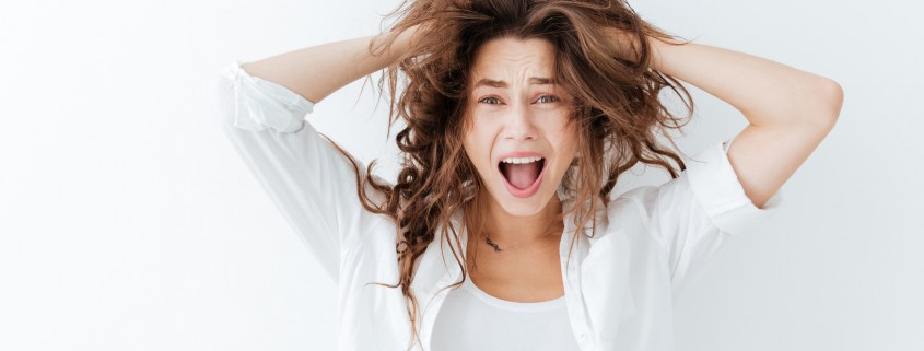 Young brunette woman with long hair shouting