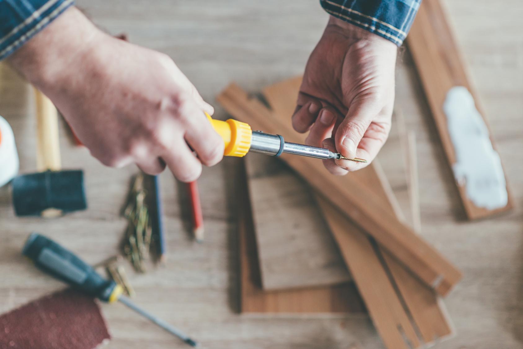 Carpenter holding a screwdriver
