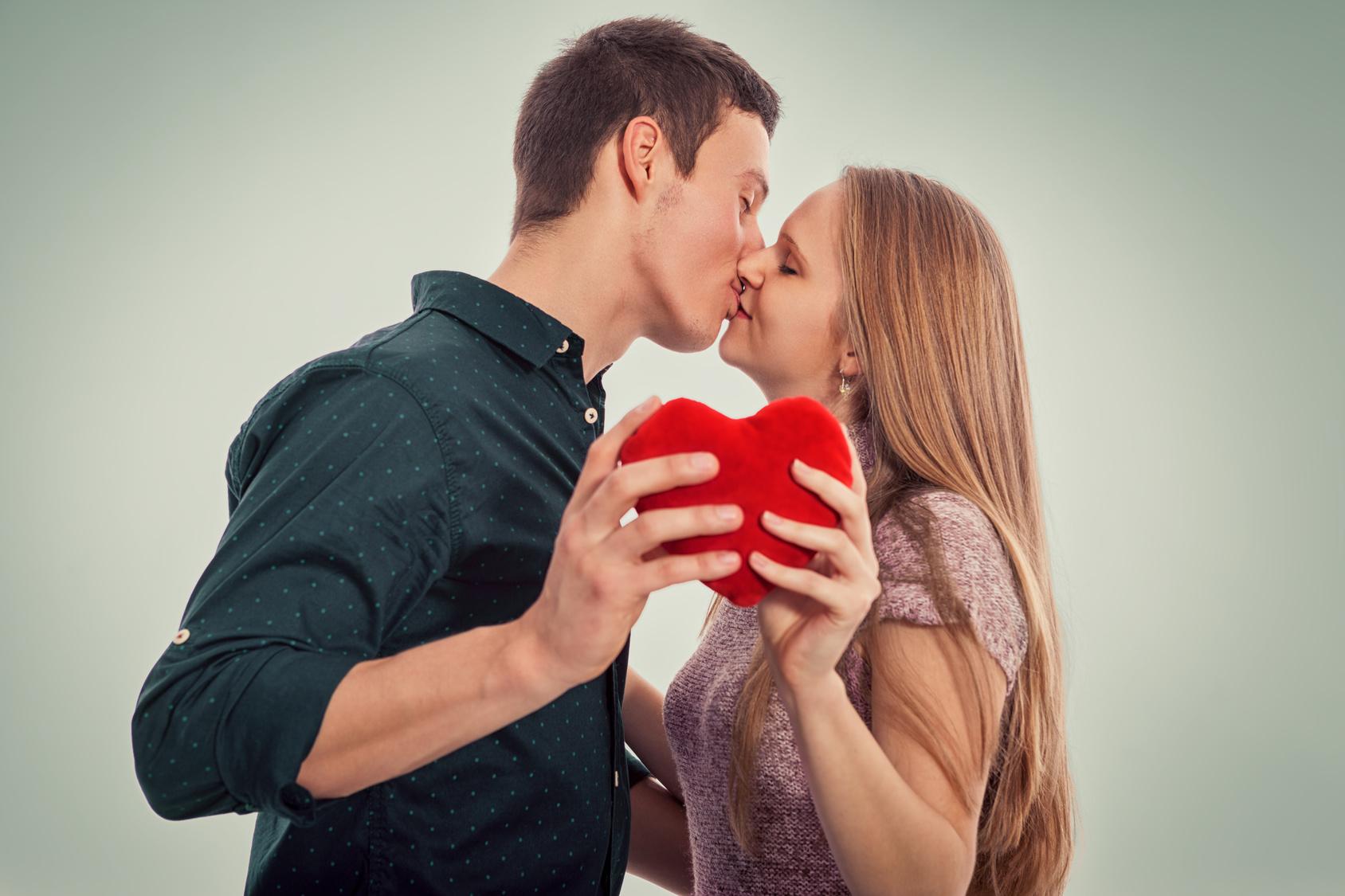 Flirting couple in love kissing