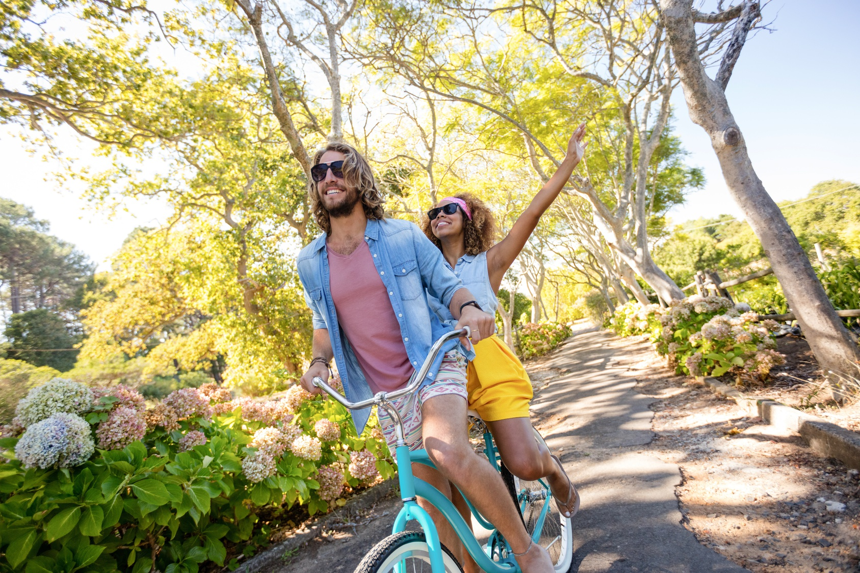 Couple having fun while cycling in the park