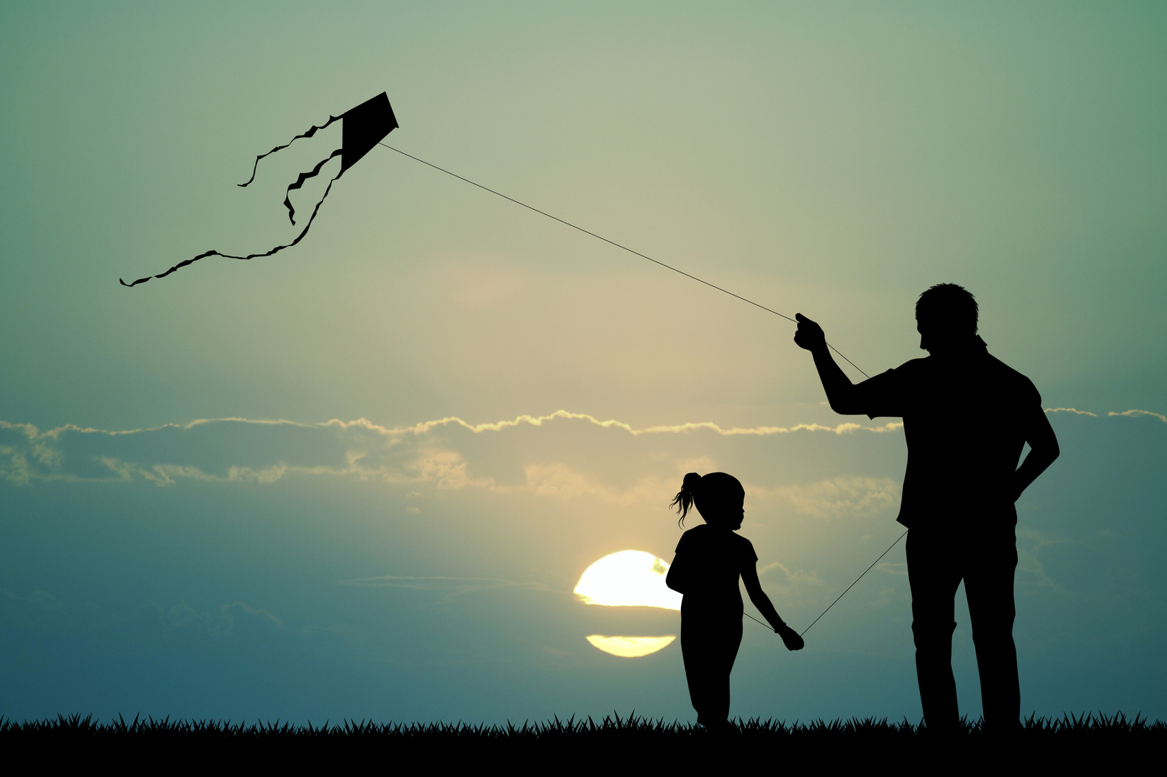 father and son with kite