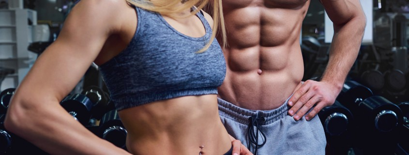 Strong man and a woman are posing with beautiful bodies.