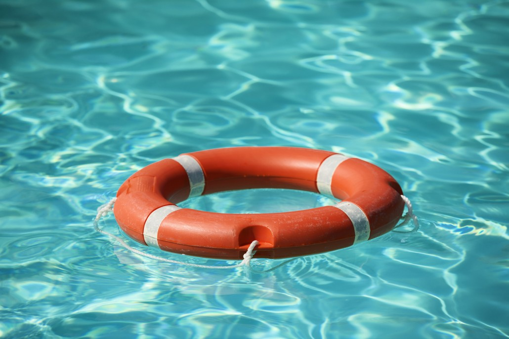 Lifesaver floating on water in swimming pool.