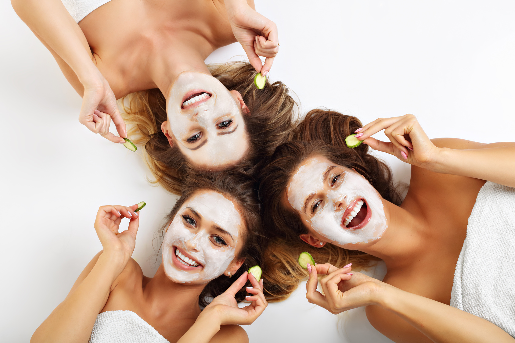Three friends with facial masks
