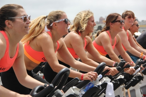 team-women-group-female-fitness-spin-cycling
