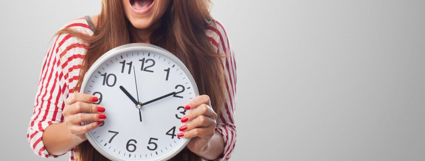portrait of a pretty woman holding a clock