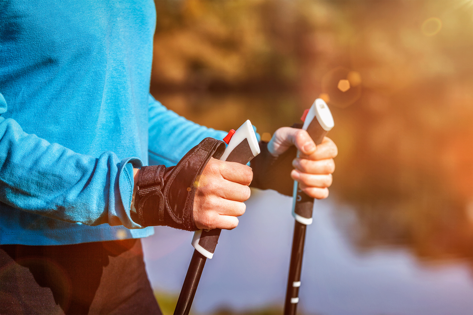 Nordic walking exercise adventure hiking concept - closeup of wo