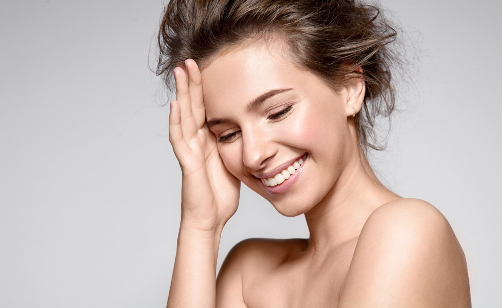 Beautiful smiling woman with clean skin and white teeth