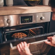woman-checking-pie-in-oven