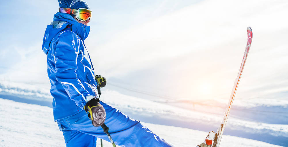Male athlete skiing in snow mountains on weekend holidays - Skie