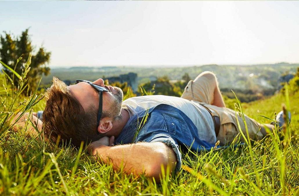man-laying-on-grass