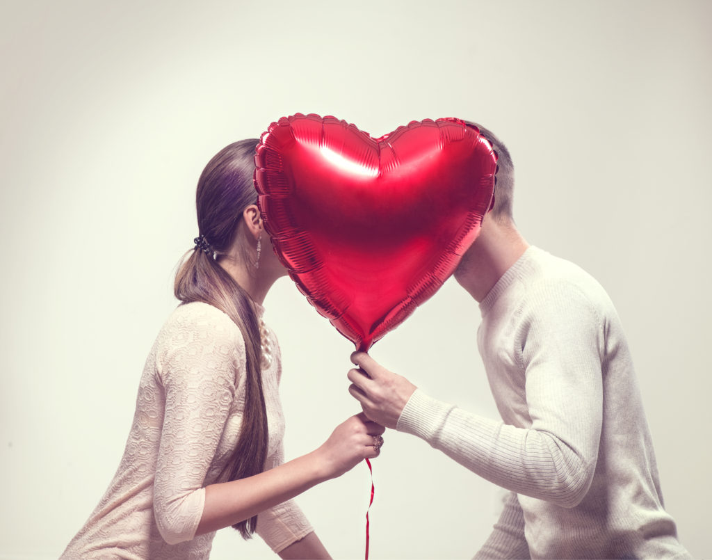 Valentine Couple. Beauty Girl and her Handsome Boyfriend holding