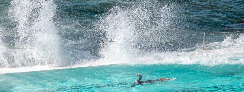 Swimmer enjoys beautiful pool along the ocean