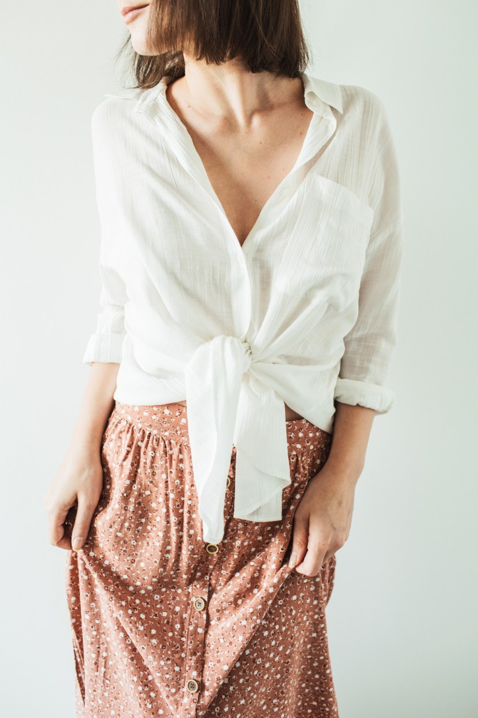 Young beautiful woman in blouse, skirt on white background. Fashion stylish trendy clothes look. Lifestyle concept.