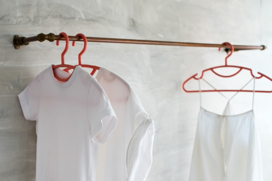 White cotton t-shirts and dresses plastic hangers