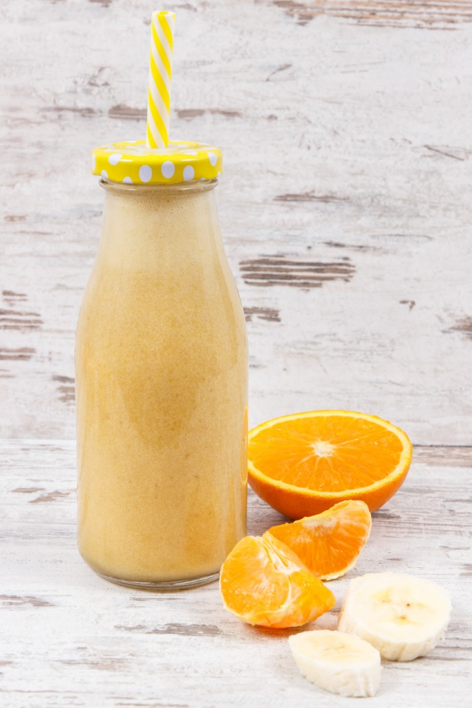 Fresh healthy coctail or juice from citrus fruits. Dessert containing vitamins and minerals