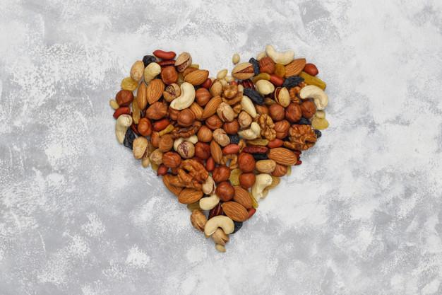 Assortment of nuts shape of heart Cashew, hazelnuts, walnuts, pi