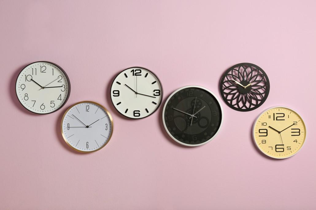 Different clocks on color background. Time management