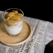 Iced Dalgona Coffee, a trendy korean style  cremy whipped coffee on fresh milk, on wooden tray on the table