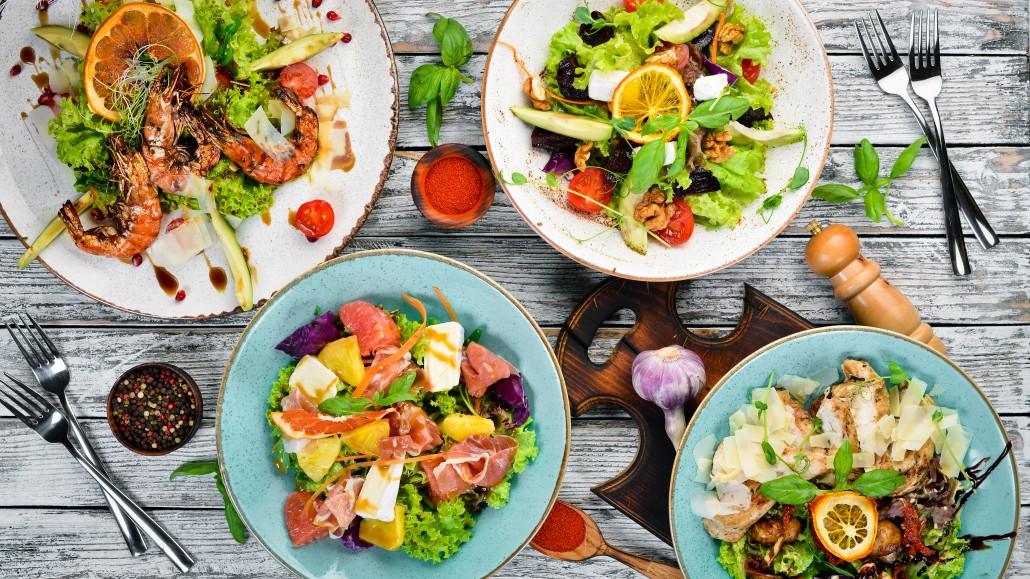 A set of salads. In the plate. Rustic style. Top view. Free space for your text.