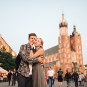 Young loving couple hugs at central square in Krakow (Cracow).