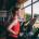 Sport girl run orbitrek gym body fitness concept.
