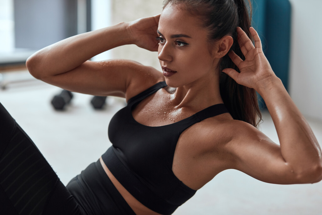 attractive sporty woman pumping press