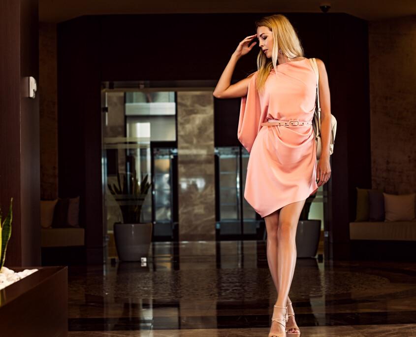 beautiful fashion woman in asymmetrical pink dress