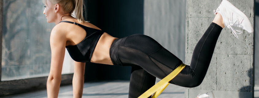 Fitness woman uses elastic band for sport